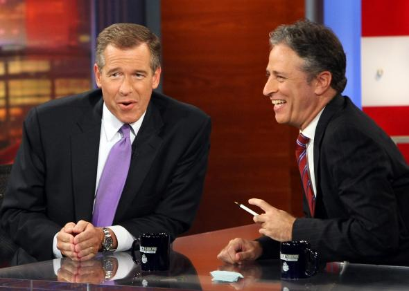 82637982-news-anchor-brian-williams-is-interviewed-by-host-jon
