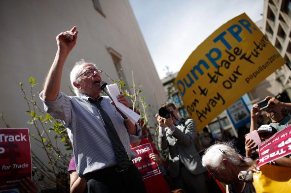 470456324-sen-bernie-sanders-speaks-to-protesters-taking-part-in