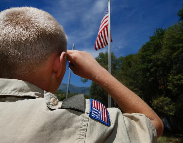482584584-boy-scout-salutes-the-american-flag-at-camp-maple-dell