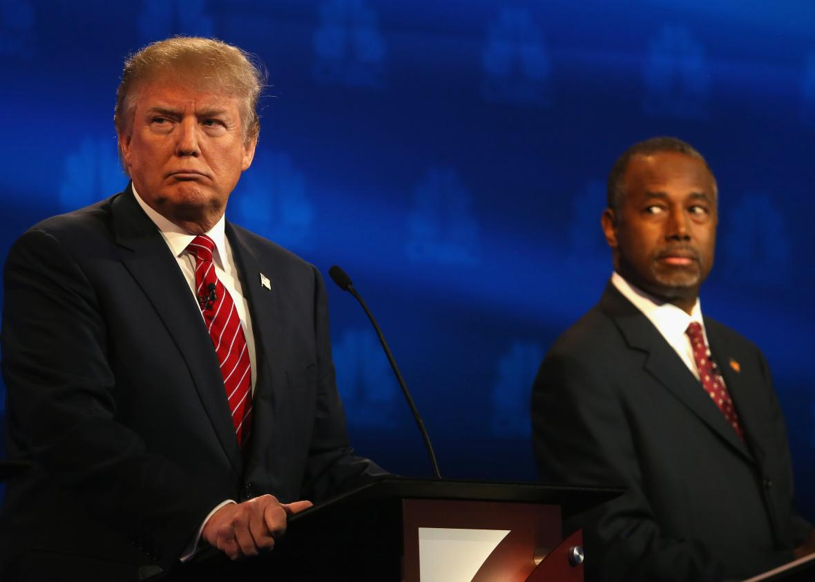 494724942-presidential-candidates-donald-trump-and-ben-carson