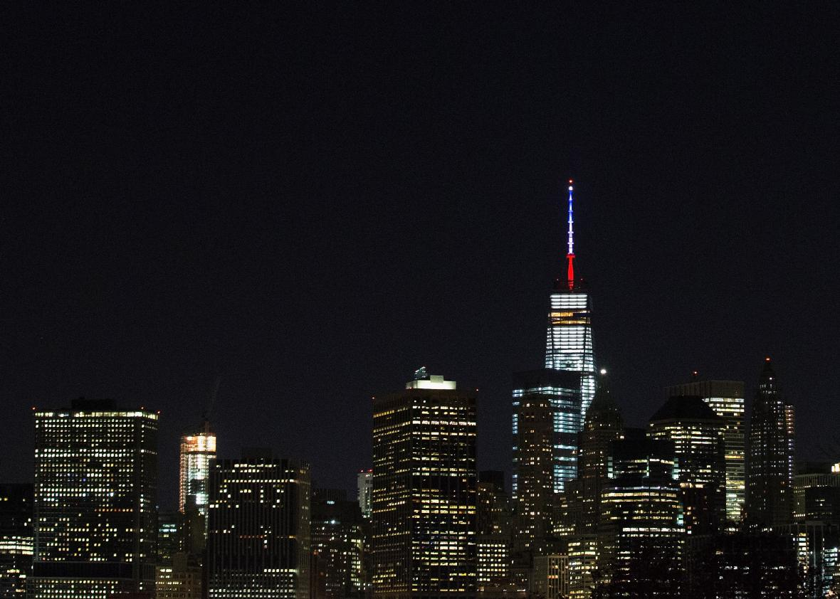 497072124-one-world-trade-centers-spire-is-shown-lit-in-french