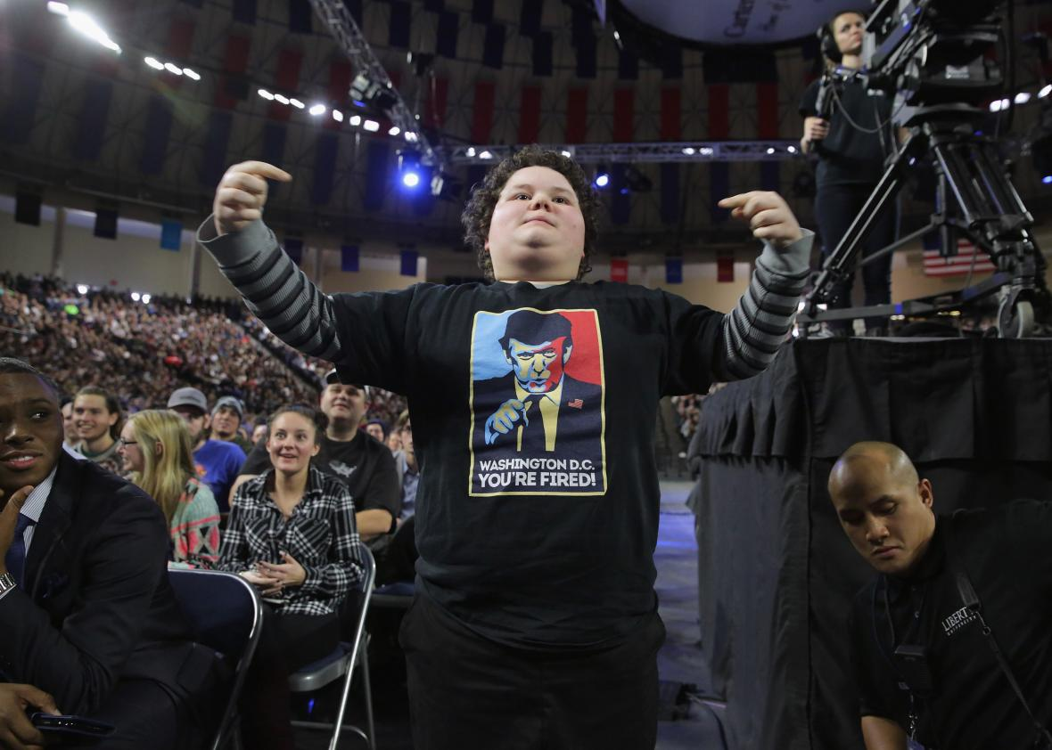 505550200-boy-stands-up-to-cheer-for-republican-presidential