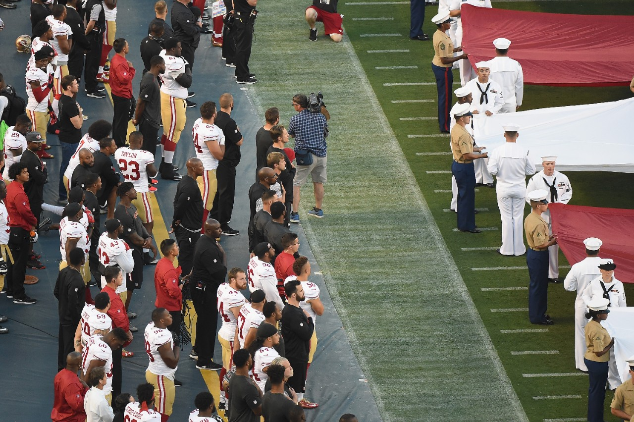 Colin Kaepernick And Eric Reid Sit Out National Anthem In