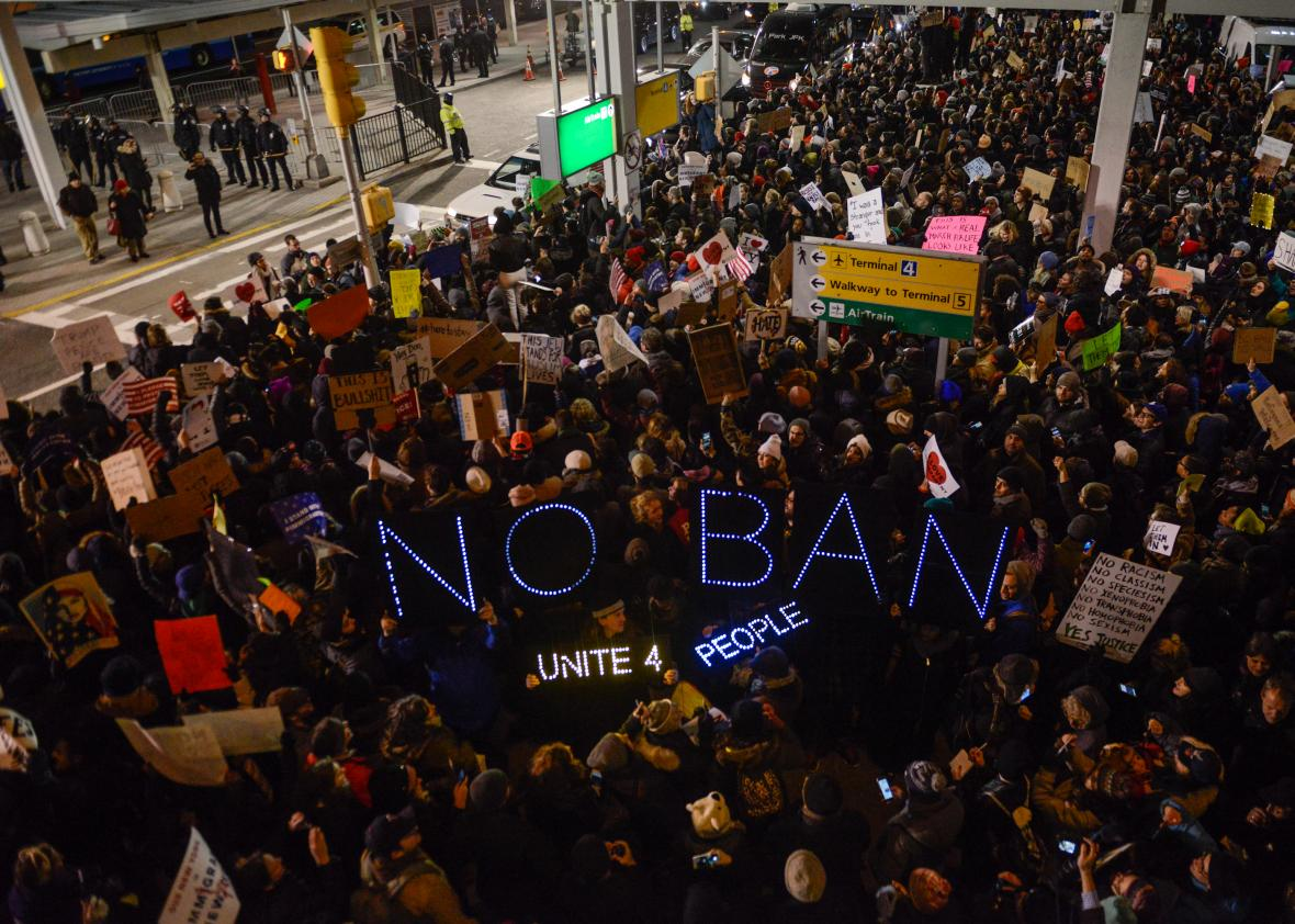 Protesters rally during a demonstration against the Muslim immigration ban at John F. Kennedy International Airport on Saturday in New York City. (Stephanie Keith/Getty)