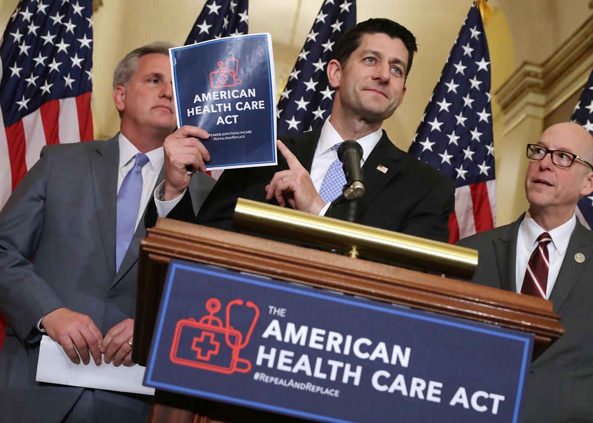 http://www.slate.com/content/dam/slate/blogs/the_slatest/2017/05/03/ahca_live_blog_it_is_happening_again/649341364-speaker-of-the-house-paul-ryan-holds-up-a-copy-of-the.jpg.CROP.promo-xlarge2.jpg