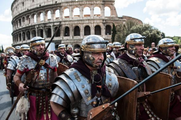 167133030-actors-dressed-as-ancient-roman-soldiers-march-in-front