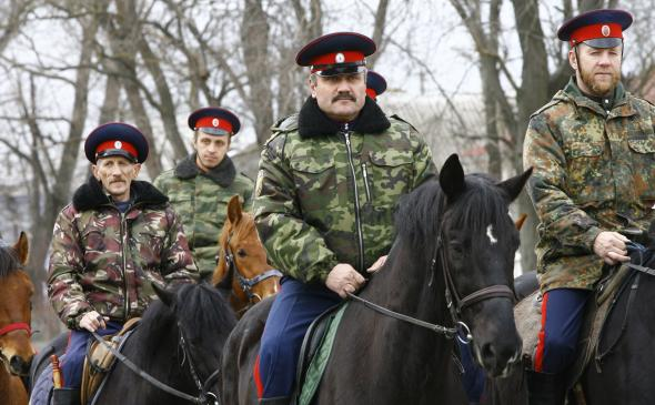 479535495-mounted-cossacks-patrol-an-area-near-russian-ukrainian