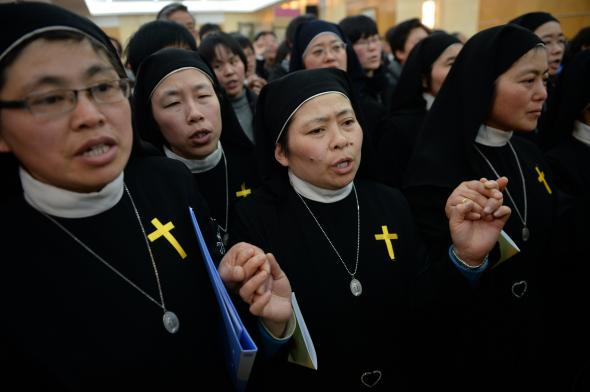 480004537-nuns-sing-at-the-funeral-of-the-late-head-of-the