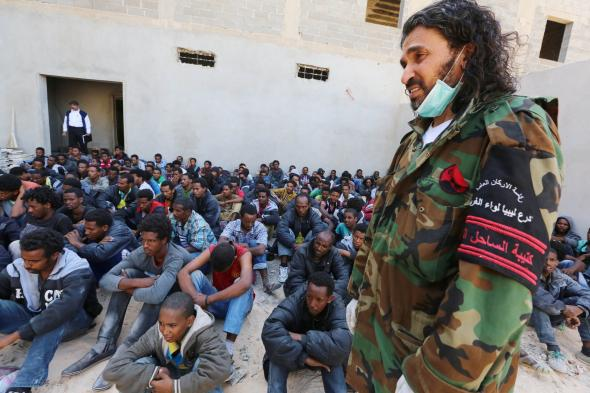 489793483-member-of-the-libyan-security-forces-stands-guard-near