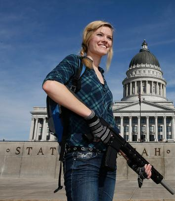 162972470-darci-lund-carries-an-ar-15-at-a-gun-rights-rally-and