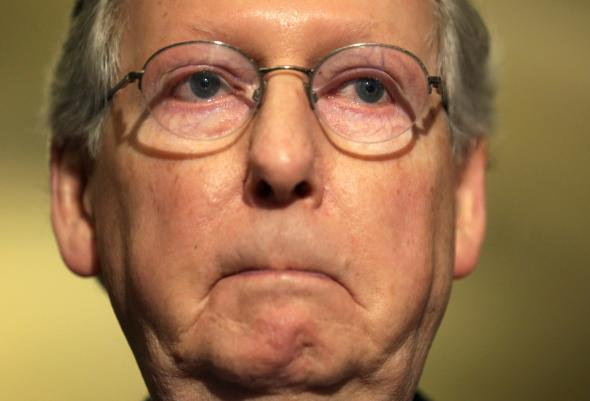 476810229-senate-minority-leader-sen-mitch-mcconnell-pauses