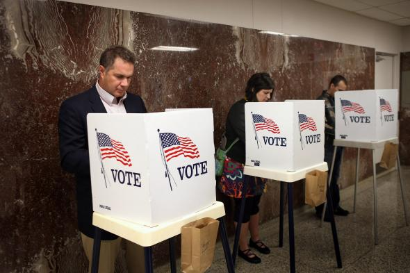 152841468-rep-bruce-braley-votes-during-early-voting-at-the-black