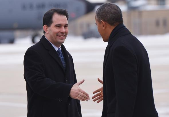 465889221-president-barack-obama-shakes-hands-with-wisconsin