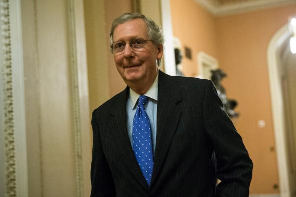 184798110-senate-minority-leader-sen-mitch-mcconnell-walks-to-the