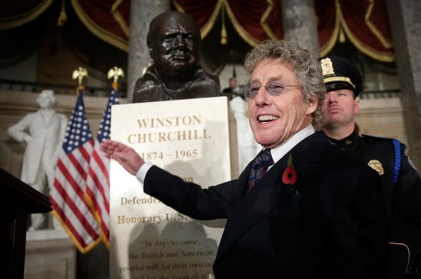 186316072-roger-daltrey-lead-singer-of-the-who-stands-by-a-bust