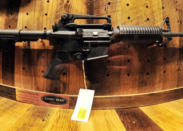 168153102-an-ar-15-rifle-to-be-raffled-off-is-seen-at-the-wall-of