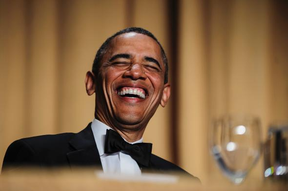 167692572-president-barack-obama-reacts-to-a-joke-told-by
