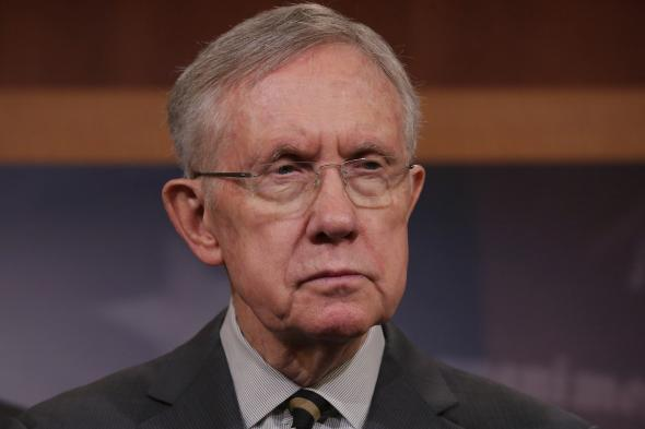487457885-senate-majority-leader-harry-reid-answers-reporters