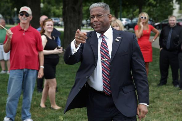 174288797-former-rep-allen-west-spots-a-friend-in-the-crowd_1