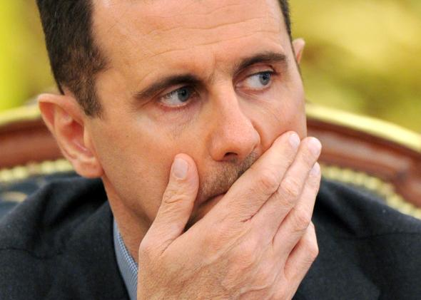 110788705-syrias-president-bashar-al-assad-gestures-as-he-speaks
