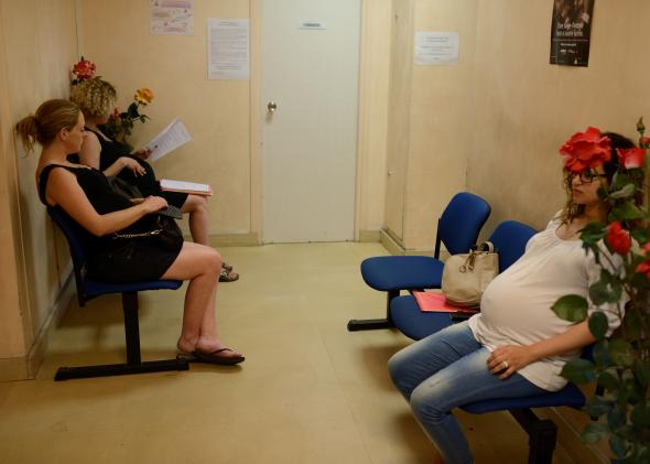 175354030-pregnant-women-wait-for-a-medical-visit-on-august-2