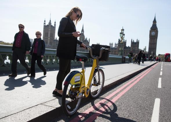 484926289-woman-stands-with-her-specially-painted-yellow-london