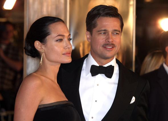 83958417-actress-angelina-jolie-and-actor-brad-pitt-arrive-at-the
