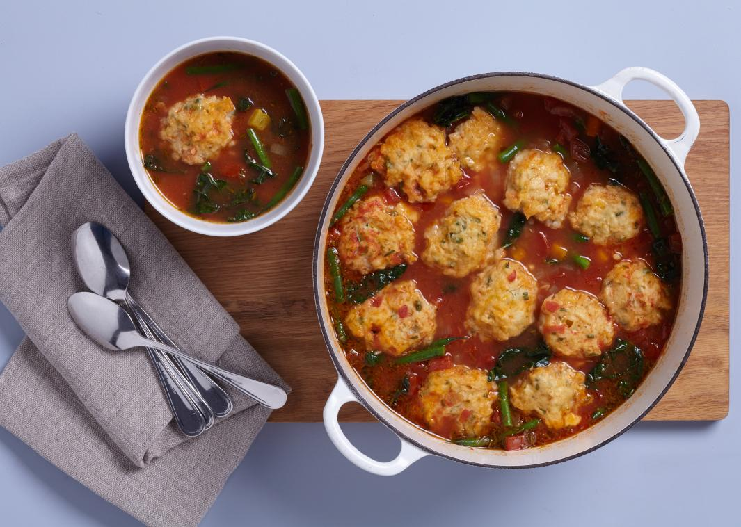 Tomato Vegetable Soup with Cheddar Cheese Dumplings