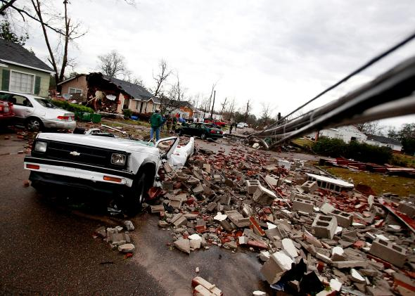 161466822-car-sits-destroyed-by-fallen-debris-after-a-tornado