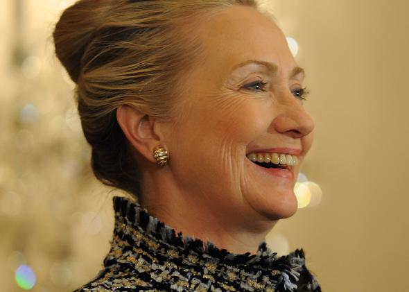 136703607-secretary-of-state-hillary-clinton-smiles-at-a-remark