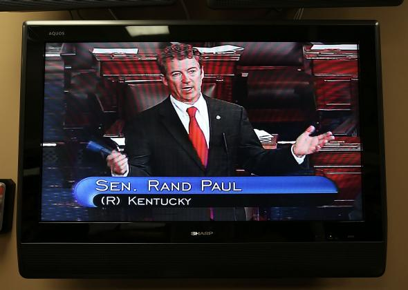 163275666-sen-rand-paul-is-seen-on-a-tv-monitor-as-he