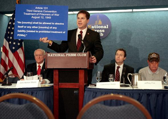 79213625-rep-bruce-braley-holds-up-a-copy-of-article-131-of-the