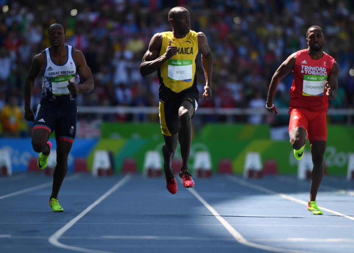 589080068-jamaicas-usain-bolt-competes-with-britains-james