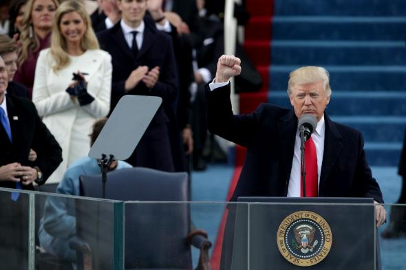 632196052-president-donald-trump-raises-a-fist-after-his