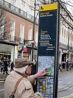 People in Mayfair using Legible London signs. Click image to expand.