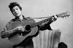 Bob Dylan poses for a portraitwith his Gibson Acoustic guitar in September 1961 in New York City, New York.