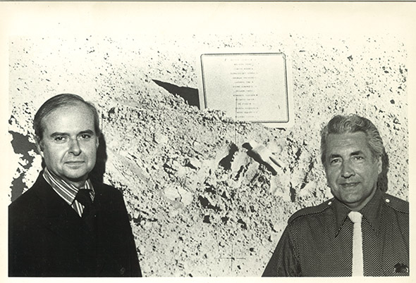 Waddell Gallery director R. H. Waddell and Van Hoeydonck seen with the NASA photograph showing the Fallen Astronaut and plaque.