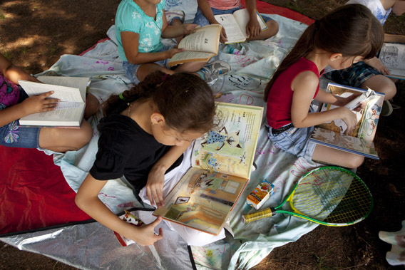 Children in summer camp read books during a literacy session August 18, 2011 in Jamaica Plain, Massachusetts.