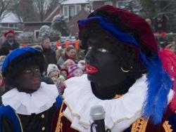 Two men dressed as Zwarte Piet for the Dutch celebration of Sinterklaas.