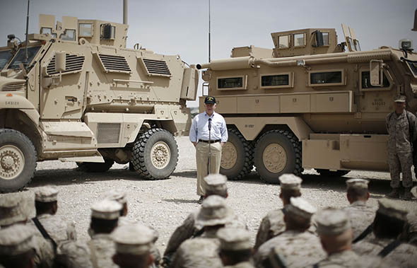 Then–Secretary of Defense Robert Gates conducts a town hall meeting with U.S. troops at the Forward Operating Base Bastion in  Afghanistan, on May 7, 2009.