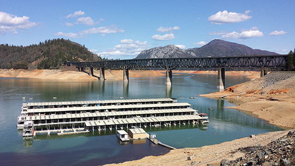 Shasta Lake, in Northern California, is only half full right now. It was built as the centerpiece of the Central Valley Project, supplying water to farmers hundreds of miles away.